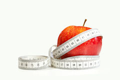 Red apple with tape measure Stock Images