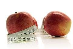 Red apple and tape measure. Over white background Royalty Free Stock Photos