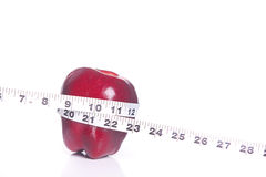 Red apple and tape measure. Stock Photos