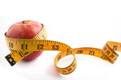 Red Apple and Tape Measure Stock Photo