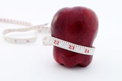 Red apple with tape measure around waist Stock Photography