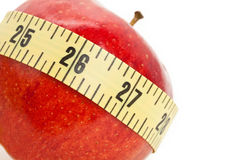 Red apple and Tape Measure Stock Photos