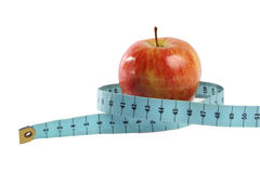Red apple in tape measure  isolated on white. On photo red apple in tape measure  isolated on white Stock Photography