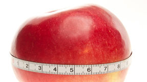 Red apple with tape measure Royalty Free Stock Photography