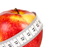 Red apple with tape measuring Royalty Free Stock Photography
