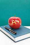 Red apple and Textbook Royalty Free Stock Photography