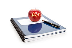 Red apple and Textbook Royalty Free Stock Photos