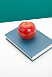 Red apple and Textbook Stock Photos
