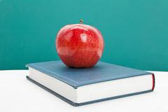Red apple and Textbook Royalty Free Stock Images