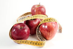 Red apple to slim. Apple symbol to publicize health and diet Royalty Free Stock Photos