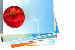 Red apple on top of book stack Royalty Free Stock Photos