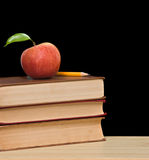 Red apple on top of books Royalty Free Stock Images
