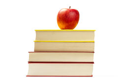 Red apple on top of some books Royalty Free Stock Photography