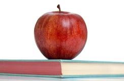 Apple on a school book Stock Photo