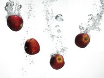 Red apple under water Stock Photo