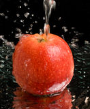 Red Apple Under Water Stream With Splashes Royalty Free Stock Image