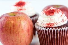 Red apple vs red velvet cupcake Royalty Free Stock Photography