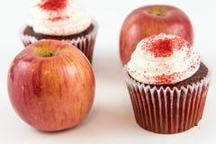 Red apple vs red velvet cupcake Stock Photo