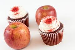 Red apple vs red velvet cupcake Stock Image
