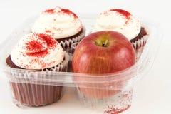 Red apple vs red velvet cupcake Stock Images