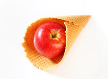 Red apple in waffle cornet Royalty Free Stock Images