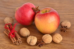 Red apple, walnuts, cinnamon and star anise Royalty Free Stock Photo