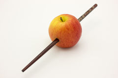 Red apple was stabbed by wooden Royalty Free Stock Photo