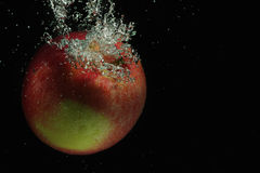 Red apple in water Stock Images