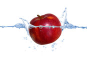 Red apple in the water Royalty Free Stock Photography