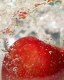Red Apple in Water Royalty Free Stock Photos