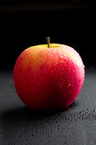 Red apple with water drops Royalty Free Stock Photo