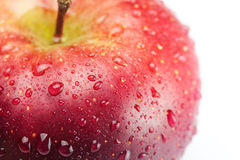 Red apple with water drops Royalty Free Stock Photos