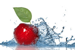 Red apple and water splash Stock Photos