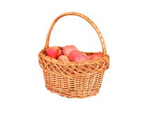 Red apple in a wattled basket Stock Photos