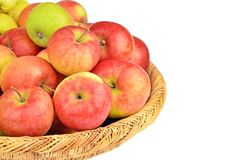Red apple in a wattled basket Royalty Free Stock Photos
