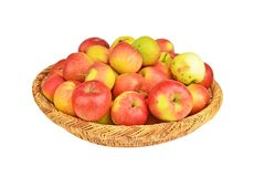 Red apple in a wattled basket Stock Image