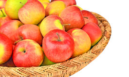 Red apple in a wattled basket Royalty Free Stock Images