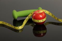 Red Apple, weight and measurement tape Stock Photo