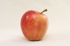 Red apple on a white background. Red and yellow apple on a white background, closeup Stock Photography