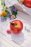 Red apple on white garden table Stock Photography
