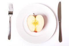 Red apple on white plate Stock Image