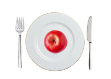 Red apple on white plate, spoon and fork isolated on white Stock Photo