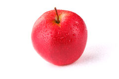 The red apple. On the white table Stock Photography