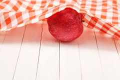 Red apple on white table covered with a tablecloth. Red apple on white wooden table covered with a tablecloth Stock Photography