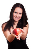 Red apple in woman hands Stock Image