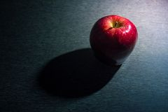 Red apple on wood stock photography