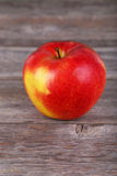 Red apple on wooden background Stock Photos