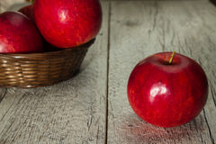 Red apple on a wooden background Stock Image