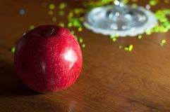 Red apple on wooden background. In bar stock images