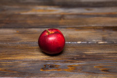 Red apple on a wooden background. Red apple, ripe appl on a wooden background close up Stock Photography